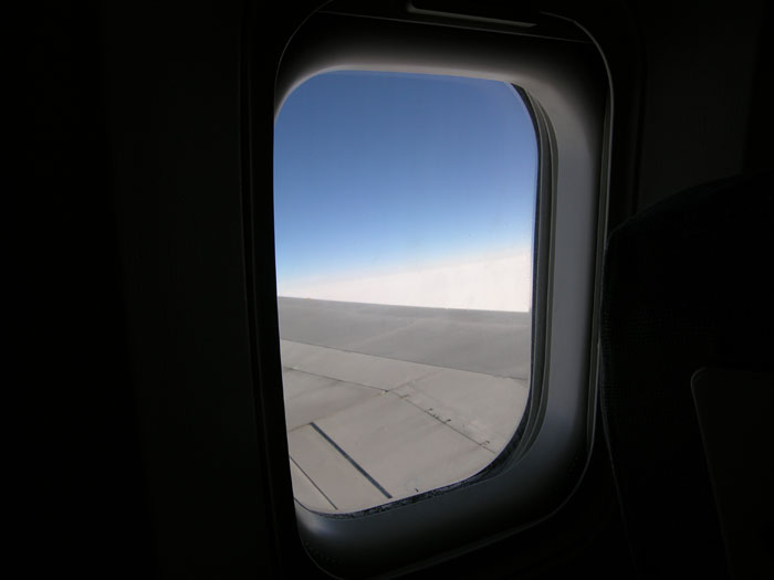 Looking out of an airplane window| All rights reserved by the image creator: Maarten Idema. Copyright 2006.